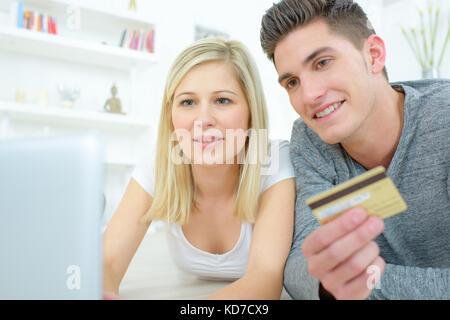 portrait of happy couple shopping online - Stock Photo