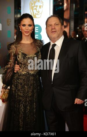 London, Great Britain. 16th Feb, 2014. US film producer Harvey Weinstein and British fashion designer Georgina Chapman - Stock Photo