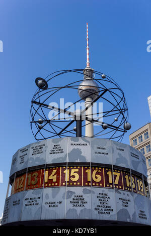 The World Clock and the TV Tower on Alexanderplatz in Berlin, Germany - Stock Photo