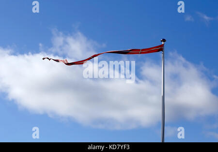 Long Flag of Denmark against blue sky - Stock Photo