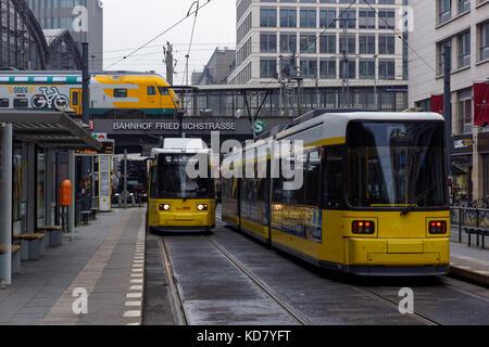 Modern trams near Friedrichstrasse station in Berlin, Germany - Stock Photo