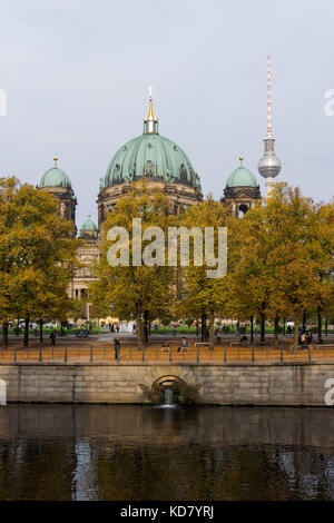 Berlin Cathedral and TV Tower seen above the Lustgarten park in Berlin, Germany - Stock Photo