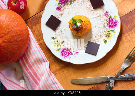 Fall snickerdoodle cookies with pumpkin and cinnamon on plate with fork and knife on wooden background - Stock Photo