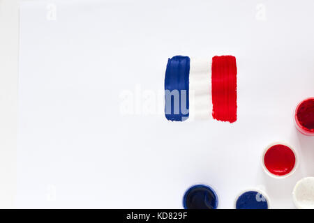 France Flag with paints and brushes on white background - Stock Photo