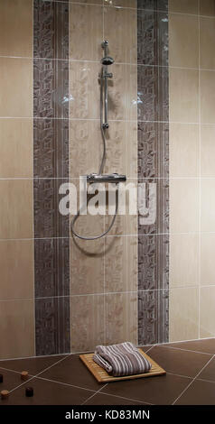 shower cabin with wall mount shower attachment - Stock Photo
