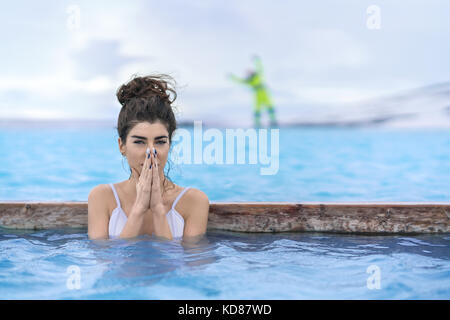 Girl relaxing in geothermal pool outdoors - Stock Photo