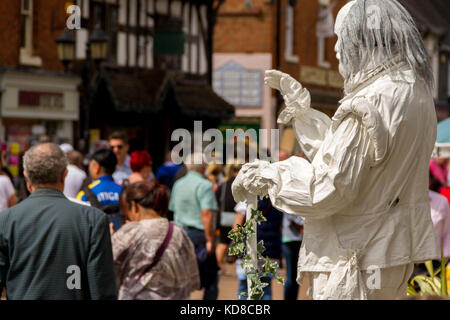 Street Artist / Living Statue performing as the Ghost of William Shakespeare for passing tourists, Henley Street, - Stock Photo