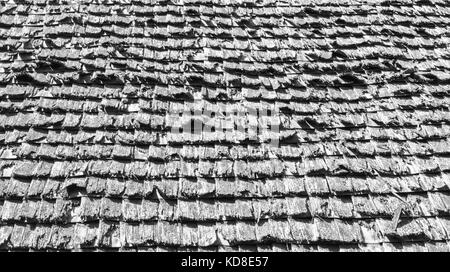 background texture weathered wooden roof shingles on a colonial building - Stock Photo