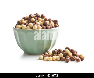 Breakfast cereal balls in bowl. Tasty breakfast. Chocolate cereals. - Stock Photo