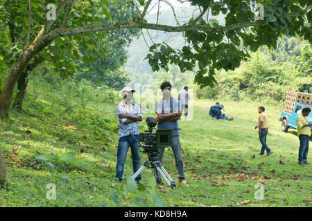 Camera man and camera operator looking on outside, film shooting spot