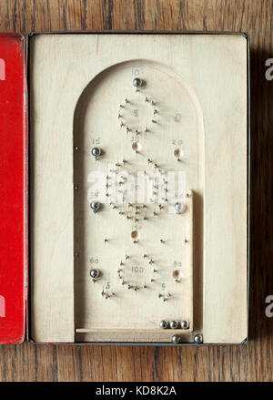 Vintage Home Made Travel Bagatelle Game in Tin Case - Stock Photo