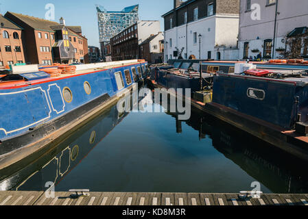 Canal on Gas Street Basin in the heart of Birmingham  looking towards the Mailbox and Cube building - Stock Photo