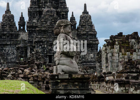 A view of Candi Sewu (Sewu Temple) with a dvarapala (guard) at the front - Stock Photo