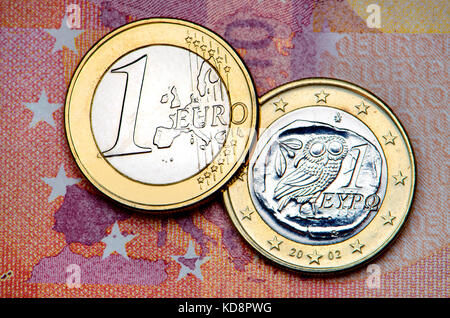 Greek Euro coin on a 10 Euro note - Stock Photo