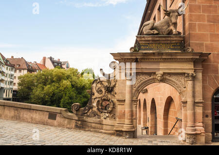 Nuremberg, Germany - August 28, 2016: The Ochsenportal (Bull portal) on the ancient Fleisch Bridge in the old town - Stock Photo