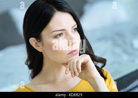 Pensive brunette girl thinking over something - Stock Photo