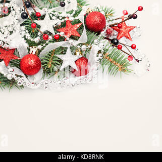 Christmas or New Year Background with Copy Space. Christmas Border of Red Handmade Decoration, Xmas Tree Twig, Silver - Stock Photo