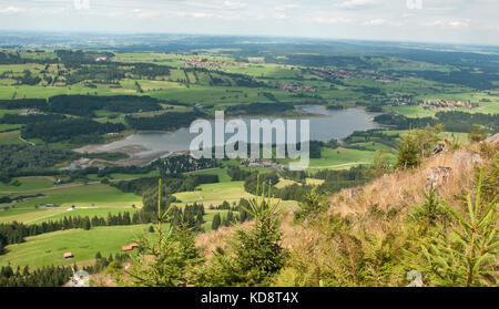 Panoramic view over the Gruentensee recreational lake and hydroelectric dam, Wertach, Bavaria, Germany - Stock Photo