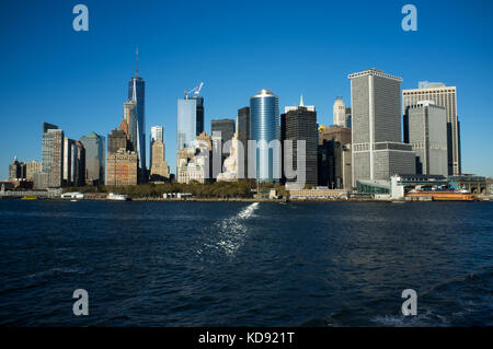 shot of Lower Manhattan cityscape taken while aboard the Staten Island ferry - Stock Photo