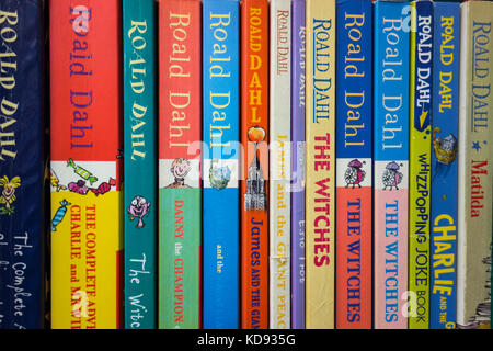 A bookshelf of Roald Dahl book spines - Stock Photo