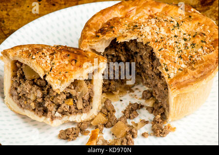 Copy space; Minced Beef Meat Pie With Vegetables In A Pastry Crust Served on a Plate - Stock & Mince meat pie served on a plate with pees coleslaw salad and ...