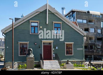 Roald Amundsen statue sculpture outside old wooden building in Polarmuseet or Polar Museum. Tromso, Troms county, - Stock Photo