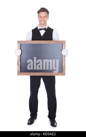 Portrait Of A Happy Smiling Waiter Holding Blank Chalkboard - Stock Photo