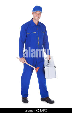 Happy Worker Holding Toolkit And Plunger Over White Background - Stock Photo