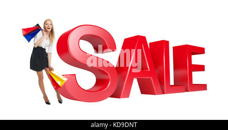 Woman with shopping bags next to sale sign. Isolated on white - Stock Photo