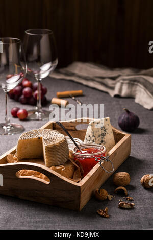 Cheese platter, nuts and fruits - Stock Photo