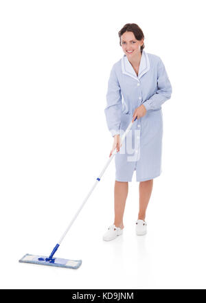 Happy Young Maid Holding Mop Over White Background - Stock Photo