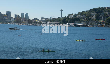 Kayaks on Seattle's Lake Union, Seattle skyline with Space Needle. View from Gas Works Park. - Stock Photo