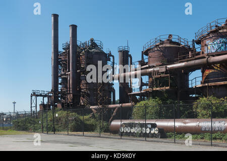 With Seattle Space Needle in distance across Lake Union, remnants of last coal gasification plant in the US are - Stock Photo