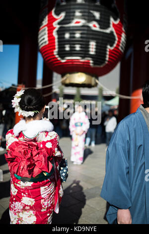 KYOTO, JAPAN - JANUARY 10 2016 : Japanese women in traditional Kimono are taking photos and selfies on the way to - Stock Photo