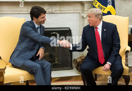 Washington DC, USA. 11th Oct, 2017. United States President Donald Trump shakes hands with Canadian Prime Minister - Stock Photo