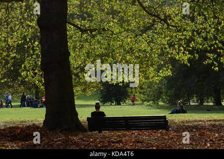 London, UK. 12th Oct, 2017. UK weather. A woman enjoys the autumn sunshine in Green Park Credit: Patricia Phillips/Alamy - Stock Photo