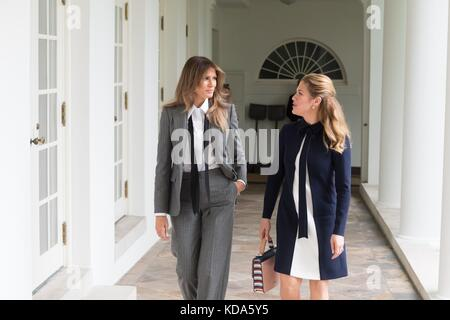 Washington, United States Of America. 11th Oct, 2017. U.S. First Lady Melania Trump, left, walks with the First - Stock Photo