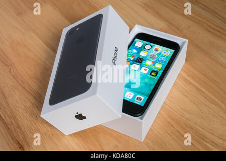 Bangkok, Thailand - October 11, 2017 : Apple iPhone 7 in the box package. - Stock Photo