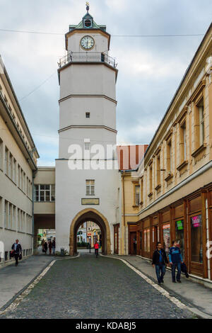 TRENCIN, SLOVAKIA - SEPTEMBER 23, 2013: View of the city tower, with locals and visitors, in Trencin, Slovakia - Stock Photo