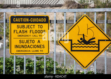 Flash flood warning sign next to Los Angeles River, Long Beach, California, USA - Stock Photo