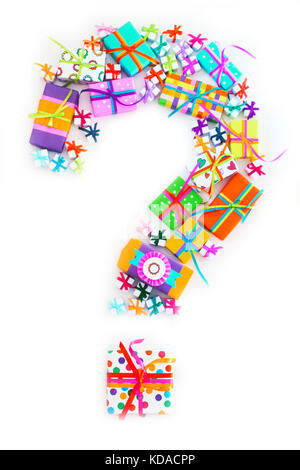 Question mark from gift boxes decorated with colorful ribbons - Stock Photo