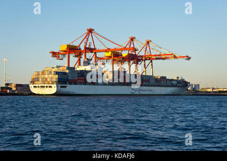 Container ship being unloaded in Port of Fremantle, Western Australia - Stock Photo
