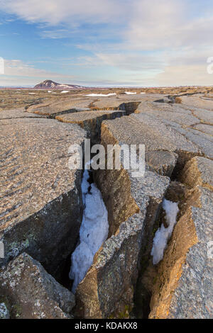Grjotagia gaping fissure / Grjótagjá tectonic crack, Mid-Atlantic Ridge running through Iceland at Eastern Mývatn - Stock Photo
