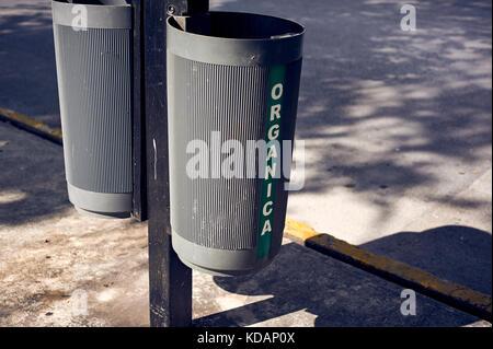 Organic and inorganic waste bins on Paseo de Montejo avenue in Merida, Yucatan, Mexico - Stock Photo