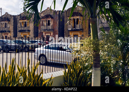 Old houses facades on parking lot by Paseo de Montejo avenue in Merida, Yucatan, Mexico - Stock Photo