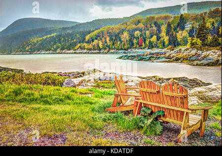 Port-au-Persil beach in Quebec, Canada Charlevoix region during stormy rainy day with Saint Lawrence river and wooden - Stock Photo