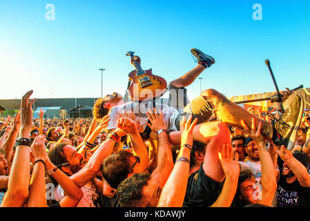 MADRID - JUN 23: Every Time I Die (metalcore music band) perform in concert with the crowd at Download (heavy metal - Stock Photo