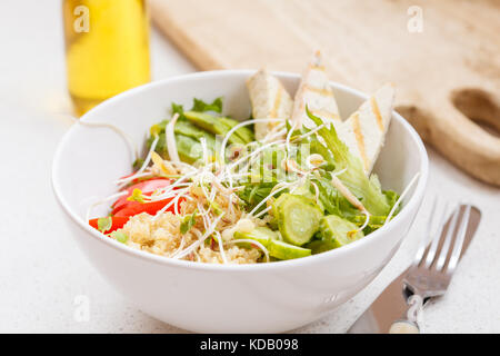 Buddha bowl of quinoa, tofu and vegetables. Vegan healthy food concept - Stock Photo