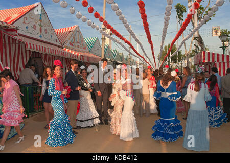April Fair, Women wearing a traditional flamenco dress, Seville, Region of Andalusia, Spain, Europe - Stock Photo