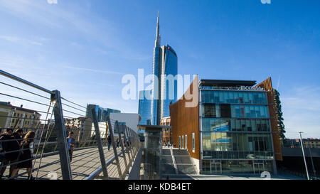 Unicredit tower and pedestrian bridge seen from Piazza Alvar Aalto, Milan, Italy. The tallest skyscraper in Italy - Stock Photo